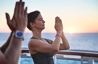 women-doing-yoga-ocean-medallion